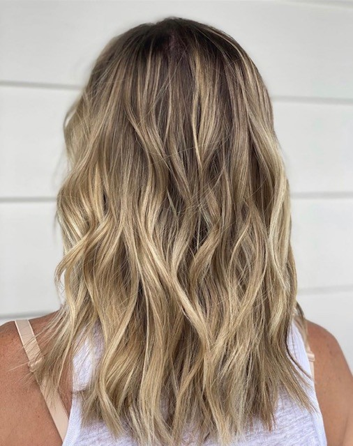 Curly, Blonde Hair with Highlights